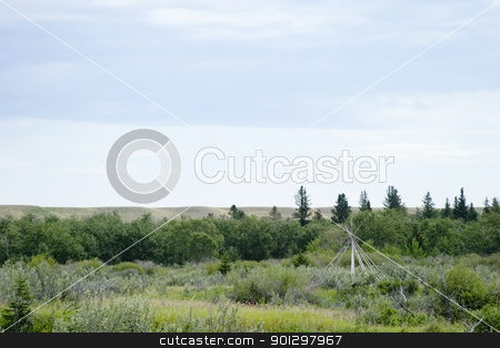 Teepee Frame Landscape stock photo, Teepee frame on the saskatchewan landscape by Tyler Olson