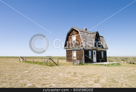 Prairie Homestead stock photo, A prairie homestead house on a skyless day. by Tyler Olson