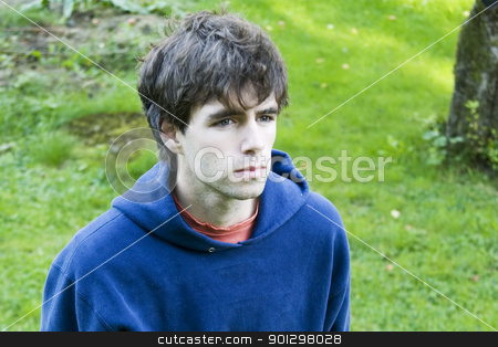 Young Male stock photo, A young male standing looking up, isolated in grass by Tyler Olson
