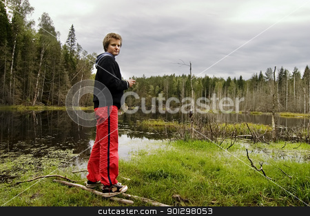 Woman near Marsh stock photo, Dead trees and other living things in a marsh near Oslo, Norway by Tyler Olson