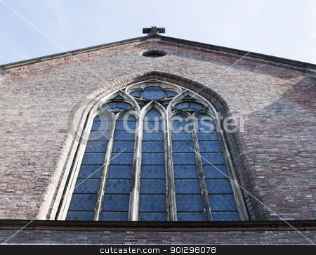 Gothic Window stock photo, A large window on a brick church building by Tyler Olson