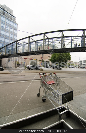 Downtown Grunge Abstract stock photo, Downtown busy grunge abstract image with shopping cart in foreground by Tyler Olson