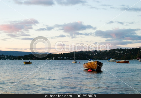 Boat in Sunset stock photo, Boat at sunset on the norwegian coast, in the Oslo fjord. by Tyler Olson