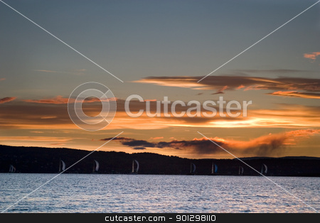 Oslo Fjord stock photo, Oslo Fjord at sunset with sail boats on the horizon by Tyler Olson