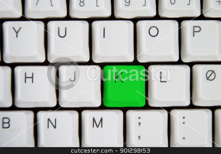 Computer Keyboard Letter K stock photo, Isolated letter K on from a computer desktop keyboard highlighted in green  by Tyler Olson