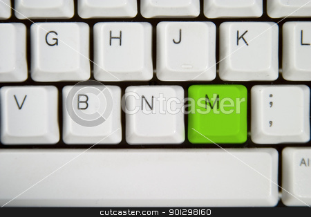 Computer Keyboard Letter M stock photo, Isolated letter M on from a computer desktop keyboard highlighted in green by Tyler Olson