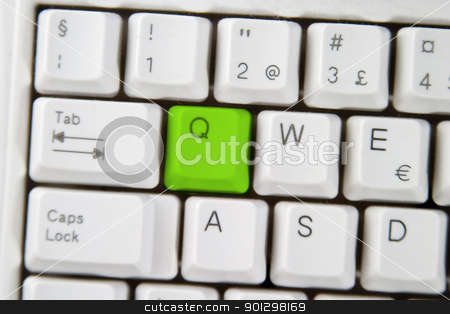 Computer Keyboard Letter Q stock photo, Isolated letter Q on from a computer desktop keyboard highlighted in green by Tyler Olson