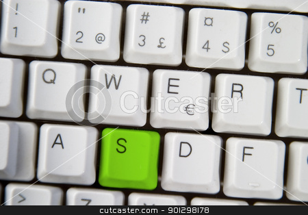 Computer Keyboard Letter S stock photo, Isolated letter S on from a computer desktop keyboard highlighted in green by Tyler Olson