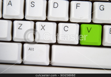 Computer Keyboard Letter V stock photo, Isolated letter V on from a computer desktop keyboard highlighted in green by Tyler Olson