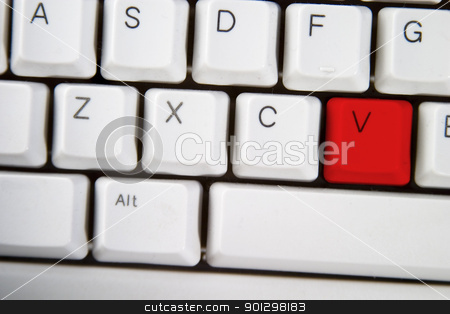Computer Keyboard Letter V stock photo, Isolated letter V on from a computer desktop keyboard highlighted in red by Tyler Olson