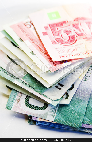 Canadian Bills stock photo, Canadian bills on a white background. by Tyler Olson