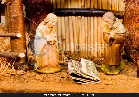 Nativity Scene with Money stock photo, Commercialism vs Christmas Mary Joseph Christ and Money by Tyler Olson