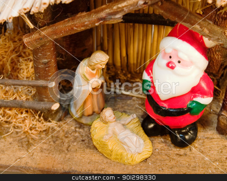Commercial Christmas stock photo, Commercialism vs Christmas Mary Santa and Christ by Tyler Olson