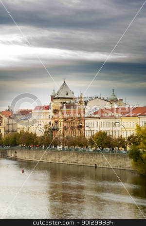 Prague Scenic stock photo, The old town bridge and tower in the background behind some buildings in old town Prague by Tyler Olson