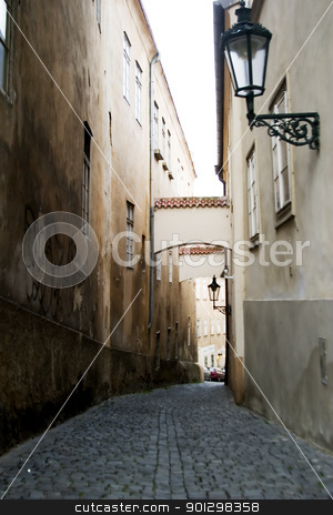 Moody Street - Prague stock photo, A dark moody image of a small skinny street in the old town area of Prague, Czech Republic. by Tyler Olson