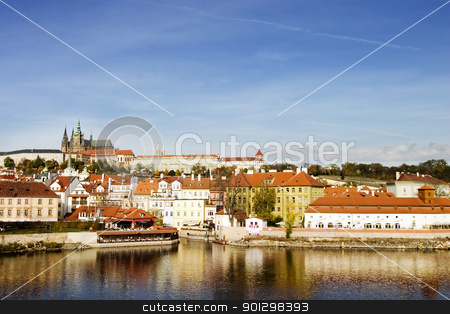 Prague Castle stock photo, Prague castle from a distance, overlooking the Vltava (or Moldau) river, Prague, Czech Republic. by Tyler Olson