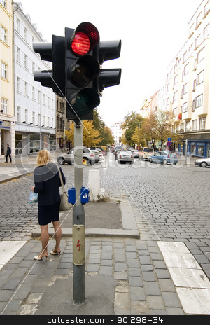 Traffic Light stock photo, A woman standing by a red traffic light in Prague, Czech Republic. by Tyler Olson