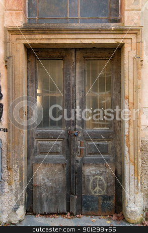 grunge weathered door stock photo, old weathered door in prague by Tyler Olson