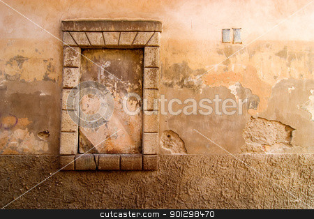 Weathered Wall Background stock photo, Window abstract detail on a street in Prague, Czech Republic. by Tyler Olson