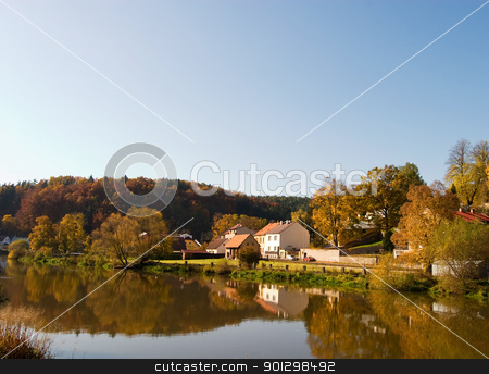Fall Reflection stock photo, A picturesque fall reflection of a quaint european village in Czech by Tyler Olson