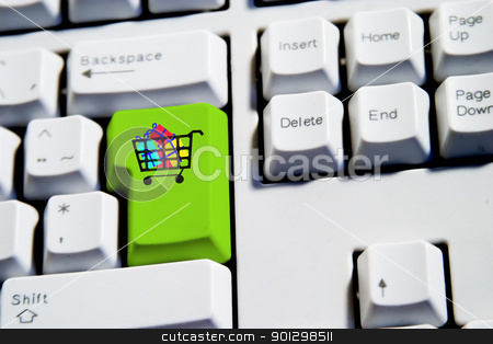 Shopping Cart stock photo, Shopping cart filled with presents on a computer keyboard. by Tyler Olson