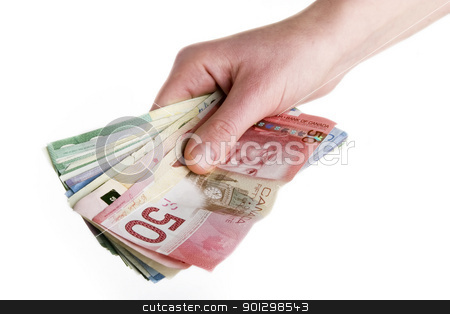 Cash in Hand stock photo, A hand full of Canadian Cash by Tyler Olson