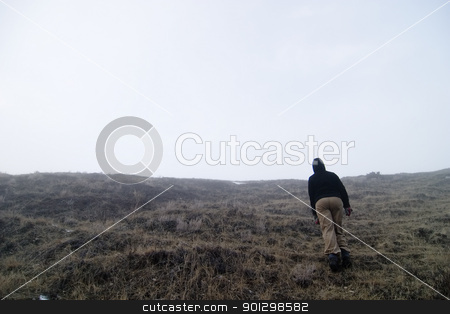 Fog Walk stock photo, Climbing up a steep hill in the fog. by Tyler Olson