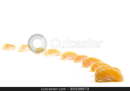 Orange Row stock photo, A row of christmas orange slices with white space at the top for text by Tyler Olson