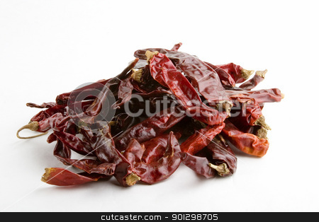Dried Chillies stock photo, Large dried chillies in a can. by Tyler Olson