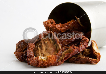 Bulk Dried Tomatoes stock photo, Bulk dried tomatoes over white by Tyler Olson