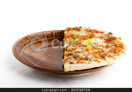 Store Bought Pizza stock photo, Half of a store bought pizza on a white background. by Tyler Olson