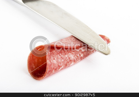 Deli Meat stock photo, A slice of deli meat rolled with a knife by Tyler Olson