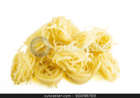 Tagliatelle stock photo, Tagliatelle pasta rolls on a white background by Tyler Olson
