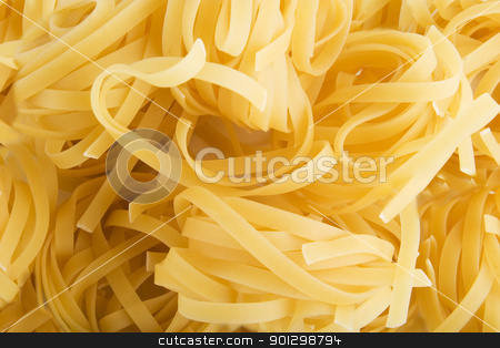 Tagliatelle Background stock photo, Tagliatelle pasta rolls background texture by Tyler Olson