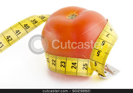 Tomato Tape Measure stock photo, A tomato wrapped in a tape measure by Tyler Olson
