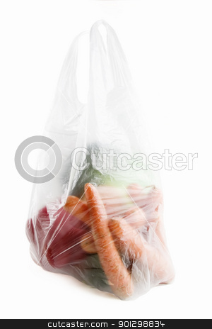Healthy Choice stock photo, Healthy vegetables in a clear plastic grocery bag on a white background by Tyler Olson