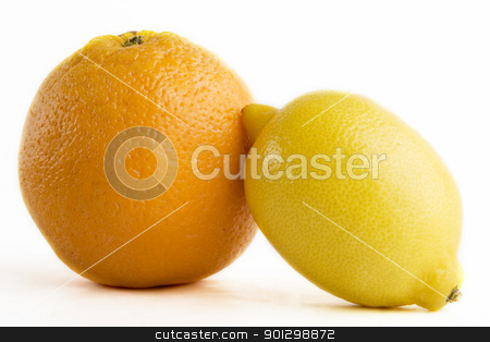 Lemon and Orange stock photo, A lemon and an orange by Tyler Olson