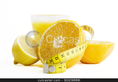 Fresh Juice - Healthy Choice stock photo, A freshly squeezed glass of citrus (orange and lemon) juice, with a tape measure by Tyler Olson