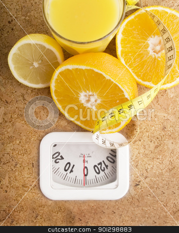 Healthy Living stock photo, Fresh fruit juice on a bathroom scale. by Tyler Olson