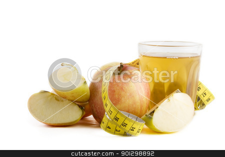 Fresh Apple Juice stock photo, Fresh apple juice with a tape measure by Tyler Olson