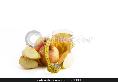 Fresh Apple Juice stock photo, Fresh apple juice with a tape measure on a large clean white background by Tyler Olson