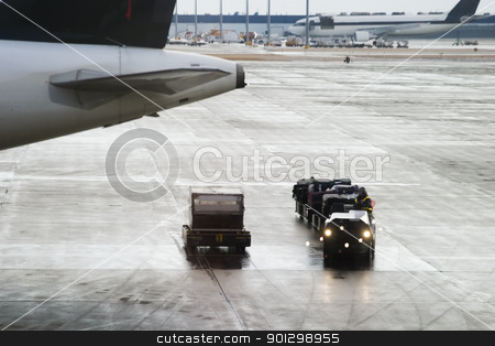 Luggage Trolly stock photo, Luggage trolly driving around at an airport. by Tyler Olson