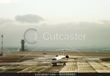 Airport Activity stock photo, An airplane taxiing on the tarmac of an airport. by Tyler Olson