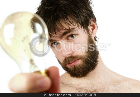 Fresh Thinking stock photo, A humor shot, of a young newly showered male, holding a light bulb, thinking up fresh new ideas. by Tyler Olson