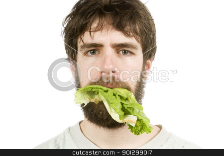 Unimpressed with Salad stock photo, A young male with lettuce in his mouth, looking unimpressed. by Tyler Olson