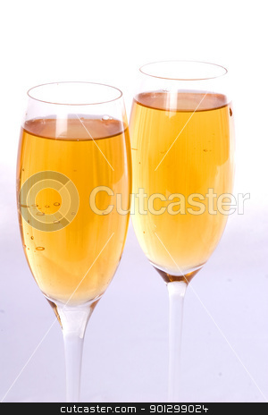 Two Champagne Glasses stock photo, champagne glasses isolated on white by Tyler Olson