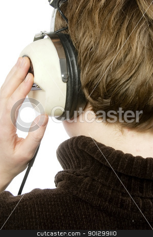 Retro Music stock photo, The back of a person head who is listening to music with large retro earphones.  Isolated on white with clipping path. by Tyler Olson