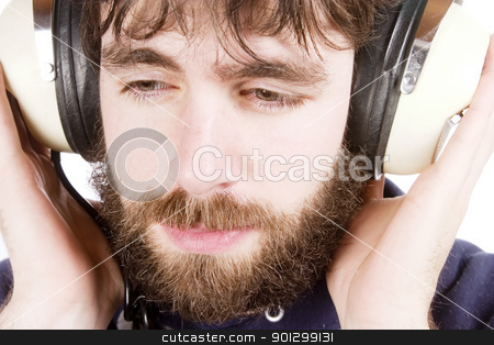 Music stock photo, A young male with a beard listening to music on headphones. Isolated on white. by Tyler Olson
