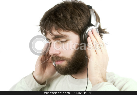 Music stock photo, A young male with a beard listening to music on headphones. Isolated on white with clipping path. by Tyler Olson