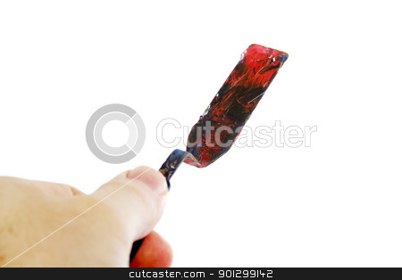 Pallet Knife stock photo, A pallet knife held in a hand.  Isolated on white with clipping path. by Tyler Olson